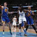From left, Golden State Warriors center Ognjen Kuzmic, of Bosnia, pulls in a loose ball as Denver Nuggets forward Kenneth Faried, center, and Warriors forward Marreese Speights cover in the fourth quarter of the Warriors' 116-112 victory in an NBA basketb