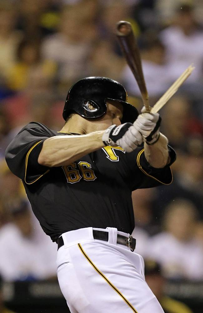 Pittsburgh Pirates' Justin Morneau breaks his bat on a fielder's choice during a baseball game against the Chicago Cubs in Pittsburgh, Thursday, Sept. 12, 2013