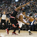 Toronto Raptors' DeMar DeRozan, right, drives past Chicago Bulls' Jimmy Butler during the first half of an NBA basketball game, Wednesday, Feb. 19, 2014 in Toronto The Associated Press