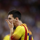 FC Barcelona Lionel Messi from Argentina reacts during a Spanish Supercup, first leg soccer match against Atletico de Madrid's at the Vicente Calderon stadium, in Madrid, Spain, Wednesday, Aug. 21, 2013. (AP Photo/Daniel Ochoa de Olza)