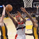 Washington Wizards forward Al Harrington, center, puts up a shot as Los Angeles Lakers forward Ryan Kelly, left, and forward Jordan Hill defend during the first half of an NBA basketball game, Friday, March 21, 2014, in Los Angeles The Associated Press