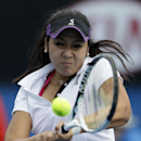 Zarina Diyas of Kazakhstan makes a backhand return to Simona Halep of Romania during their third round match at the Australian Open tennis championship in Melbourne, Australia, Saturday, Jan. 18, 2014.(AP Photo/Aijaz Rahi)