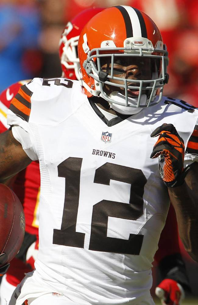 In this Oct. 27, 2013, photo, Cleveland Browns wide receiver Josh Gordon (12) runs during an NFL football game against the Kansas City Chiefs in Kansas City, Mo. Police say Gordon was arrested and charged with driving while intoxicated after speeding down a street in Raleigh, N.C. Police spokesman Jim Sughrue said Gordon was taken into custody after being pulled over for going 50 mph in a 35 mph zone on U.S. 70 in northwest Raleigh around 3 a.m. Saturday, July 5, 2014. Gordon was released on bail