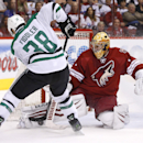 Phoenix Coyotes' Thomas Greiss, right, of Germany, makes a save on a shot by Dallas Stars' Vernon Fiddler (38) during the second period of an NHL hockey game on Sunday, April 13, 2014, in Glendale, Ariz. The Coyotes defeated the Stars 2-1 The Associated