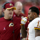 Washington Redskins head coach Jay Gruden, left, talks with DeSean Jackson (11) during the first half of an NFL football game against the Arizona Cardinals, Sunday, Oct. 12, 2014, in Glendale, Ariz The Associated Press