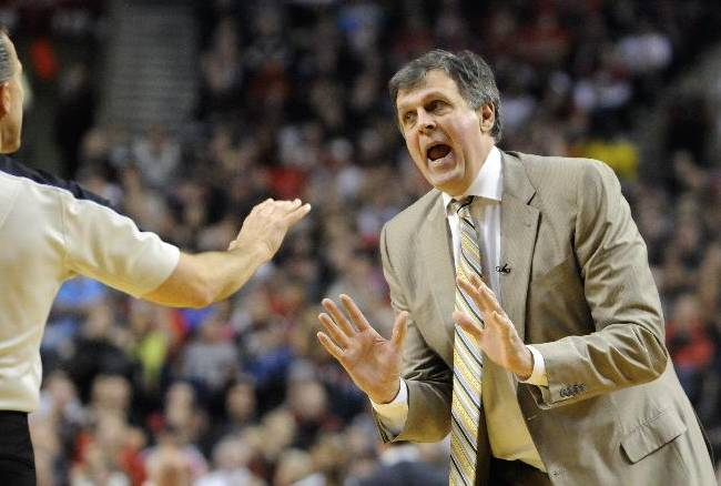 Houston Rockets' head coach Kevin McHale questions technical foul called on Dwight Howard during the first half of game four of an NBA basketball first-round playoff series game against the Portland Trail Blazers in Portland, Ore., Sunday March 30, 2014