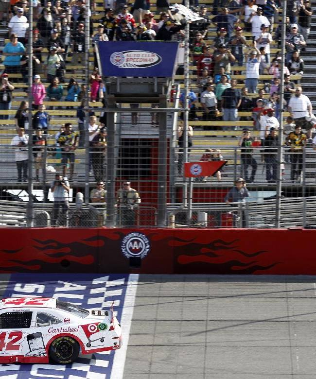 Kyle Larson (42) crosses the finish line to win the NASCAR Nationwide Series auto race in Fontana, Calif., Saturday, March 22, 2014