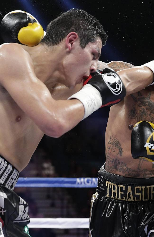 Pablo Cesar Cano, left, exchanges punches with Ashley Theophane in the third round during a welterweight fight, Saturday, Sept. 14, 2013, in Las Vegas
