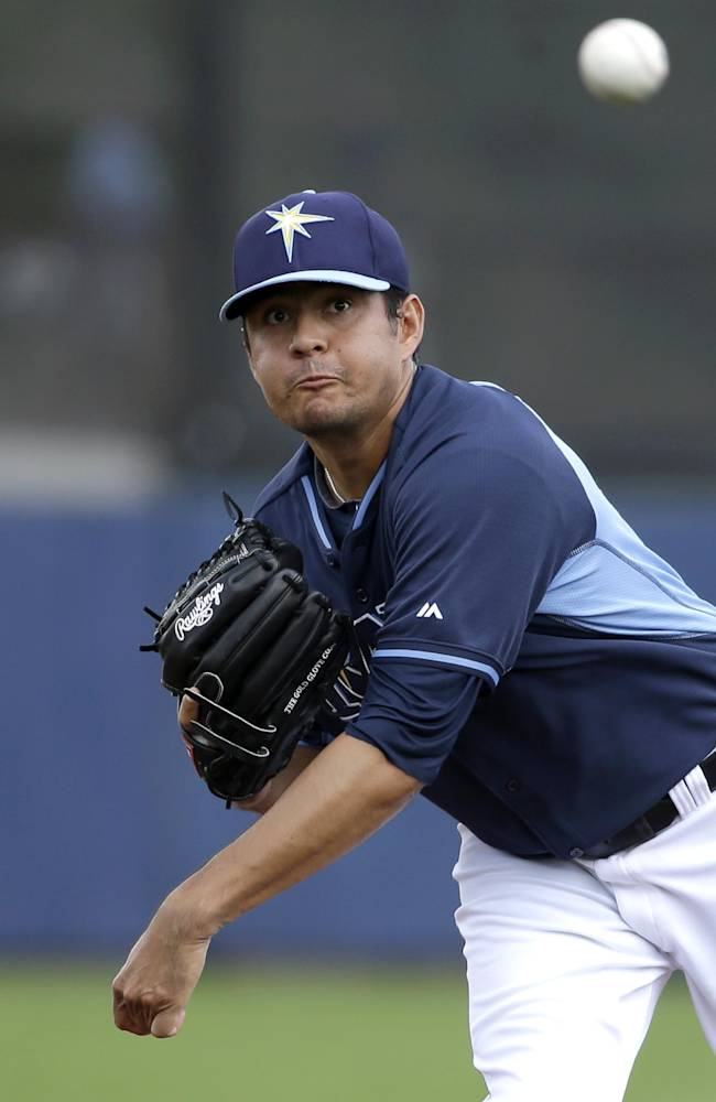 Tampa Bay Rays pitcher Cesar Ramos warms up in the first inning of an exhibition baseball game against the New York Yankees, Wednesday, March 5, 2014, in Port Charlotte, Fla