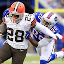 Cleveland Browns running back Terrance West (28) breaks away from a tackle by Buffalo Bills cornerback Corey Graham (20) during the first half of an NFL football game, Sunday, Nov. 30, 2014, in Orchard Park, N.Y The Associated Press