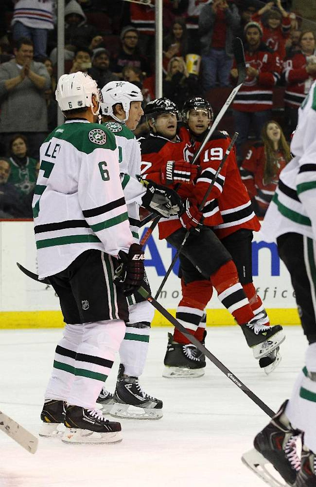 New Jersey Devils right wing Michael Ryder is congratulated by teammate New Jersey Devils center Travis Zajac (19) after scoring a goal against Dallas Stars goalie Kari Lehtonen (32), of Finland, during the second period of an NHL hockey game Thursday, Jan. 9, 2014, in Newark, N.J