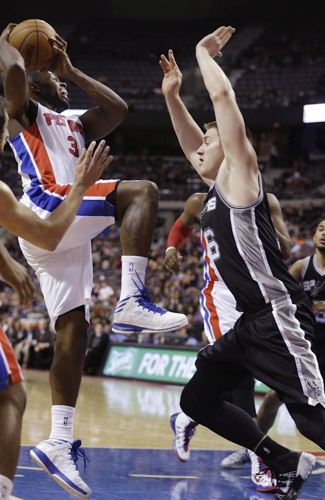 Detroit Pistons guard Rodney Stuckey (3) shoots over San Antonio Spurs forward Aron Baynes (16) during the second half of an NBA basketball game in Auburn Hills, Mich., Monday, Feb. 10, 2014