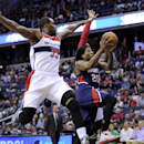 Atlanta Hawks forward Cartier Martin (20) goes to the basket against Washington Wizards forward Trevor Booker (35) during the first half of an NBA basketball game, Saturday, March 29, 2014, in Washington The Associated Press