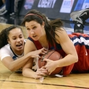 Purdue's KK Houser, left, battles Liberty's Reagan Miller for a loose ball during th first half of a first round game in the women's NCAA college basketball tournament in Louisville, Ky., Sunday March 24th, 2013. (AP Photo/Timothy D. Easley