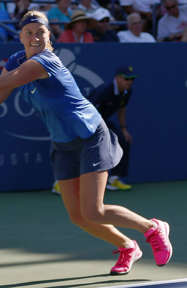 Petra Kvitova, of the Czech Republic, returns a shot to Petra Cetkovska, of the Czech Republic, during the second round of the 2014 U.S. Open tennis tournament, Thursday, Aug. 28, 2014, in New York