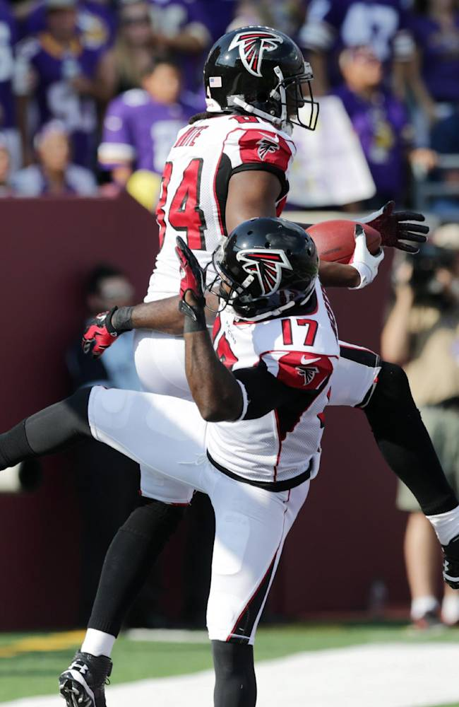 Atlanta Falcons wide receiver Roddy White (84) reacts with teammate Devin Hester (17) after catching a 24-yard touchdown pass during the first half of an NFL football game against the Minnesota Vikings, Sunday, Sept. 28, 2014, in Minneapolis.