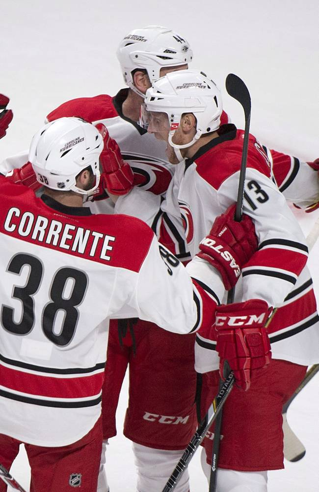 Carolina Hurricanes celebrate a first-period goal against the Montreal Canadiens during an NHL hockey preseason game in Montreal, Saturday, Sept. 21, 2013