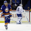 New York Islanders' Michael Grabner (40) skates past Toronto Maple Leafs goalie Jonathan Bernier (45) after scoring a goal during the first period of an NHL hockey game Thursday, Feb. 27, 2014, in Uniondale, N.Y The Associated Press