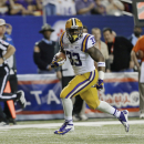 LSU running back Jeremy Hill runs the ball into the end zone during the first half of the Chick-fil-A Bowl NCAA college football game against Clemson, Monday, Dec. 31, 2012, in Atlanta. (AP Photo/David Goldman)