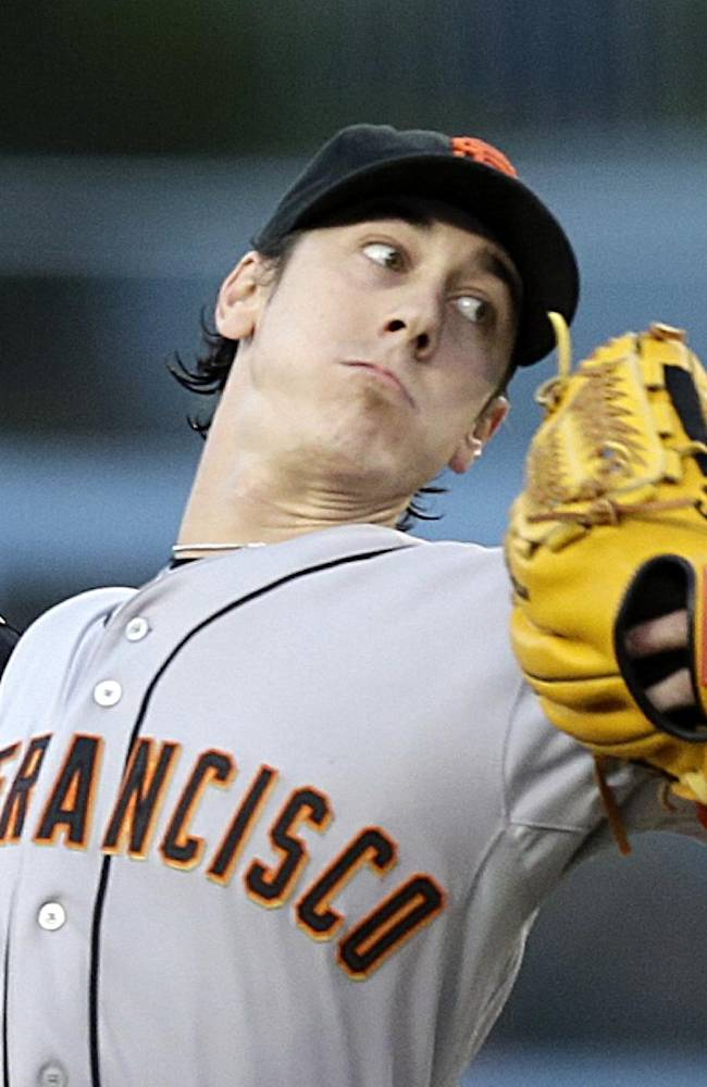In this Sept. 14, 2013 file photo, San Francisco Giants starter Tim Lincecum pitches to the Los Angeles Dodgers in the first inning of a baseball game in Los Angeles.  Lincecum is back with the Giants for two more years and alongside healthy Ryan Vogelsong in a talented rotation, while Michael Morse is ready to take over as left fielder and middle-of-the lineup force for a club looking to contend after missing the playoffs one year after a World Series title