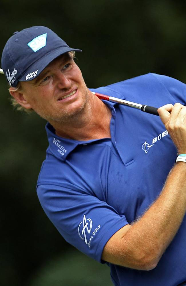 Ernie Els, of South Africa, watches his tee shot on the second hole during final round play at The Barclays golf tournament Sunday, Aug. 24, 2014, in Paramus, N.J