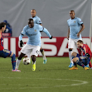 Manchester City's Yaya Toure, second left, battles for the ball with CSKA's Bebras Natcho, left, during the Champions League Group E soccer match between CSKA Moscow and Manchester City at Arena Khimki stadium in Moscow, Russia, Tuesday Oct. 21, 2014