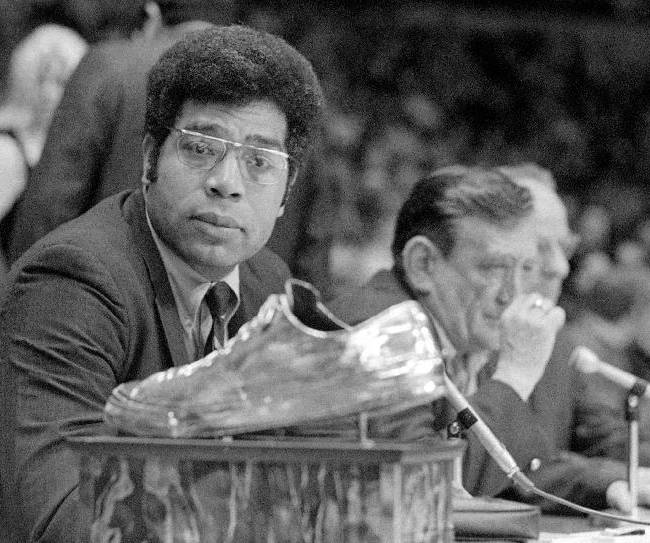 In this Dec. 20, 1969, file photo, former Milwaukee Bucks center Wayne Embry, was honored for his leadership contributions to the Bucks first year, looks over trophy made from his basketball shoe as the Boston Celtics played the Bucks in Milwaukee. Embry fought racism for decades, by refusing to let it defeat him. Drafted into the NBA in 1958, when quotas limited the number of black players, he was the only African-American on the Cincinnati Royals, and later became the NBA's first black general manager.  He thinks that the NBA's punishment of Los Angeles Clippers owner Donald Sterling is appropriate, and sends a powerful statement: