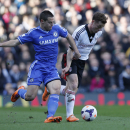 Fulham's Scott Parker, right, competes with Chelsea's Cesar Azpilicueta during their English Premier League soccer match at Craven Cottage, London, Saturday, March 1, 2014