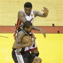Miami Heat forward Udonis Haslem (40) fouls San Antonio Spurs small forward Kawhi Leonard (2) during the first half of Game 1 of basketball's NBA Finals, Thursday, June 6, 2013 in Miami. (AP Photo/Wilfredo Lee)