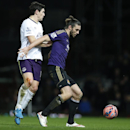 West Ham United's Andy Carroll, right, shields the ball from Everton's Gareth Barry during their English FA Cup third round replay soccer match between West Ham United and Everton at the Boleyn Ground stadium in London, Tuesday, Jan. 13, 2015