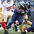 Seattle Seahawks Marshawn Lynch, center, carries the ball as he rushes against the San Francisco 49ers in the first half of an NFL football game, Sunday, Dec. 14, 2014, in Seattle The Associated Press