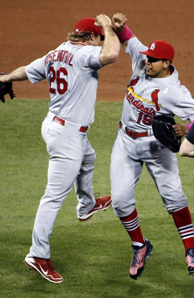 St. Louis Cardinals' Jon Jay celebrates with closer Trevor Rosenthal (26) after getting the final out in the ninth inning of a baseball game against the Pittsburgh Pirates in Pittsburgh, Sunday, May 11, 2014. The Cardinals won 6-5