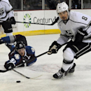 Colorado Avalanche's Gabriel Landeskog, left, and L.A. Kings' Drew Doughty reach for the puck during the first period of an NHL preseason hockey game Thursday, Oct. 2, 2014, in Colorado Springs, Colo The Associated Press