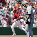 Utley homers twice for Phillies in 4-4 tie with Tigers The Associated Press