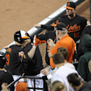 Baltimore Orioles' Chris Davis (19) celebrates his two-run home run during the fifth inning of a baseball game against the Cleveland Indians, Friday, May 23, 2014, in Baltimore. (AP Photo/Nick Wass)
