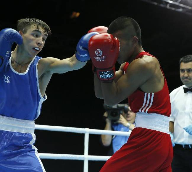 Michael Conlan of Northern Ireland, left, fights Matthew Martin from Nauru during their men's bantam weight (56kg) boxing contest at the Commonwealth Games Glasgow 2014, in Glasgow, Scotland, Friday, July, 25, 2014