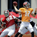 Tampa Bay Buccaneers quarterback Josh McCown (12) throws a pass as he is pressured by defensive end Michael Johnson (90) during an NFL football training camp Sunday, Aug. 10, 2014, in Tampa, Fla The Associated Press