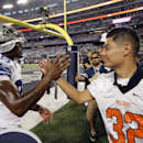 Dallas Cowboys cornerback Brandon Carr (39) greets North Dallas High School student Luis Chaparro before the Cowboys' NFL football game against the New Orleans Saints, Sunday, Sept. 28, 2014, in Arlington, Texas. The Associated Press