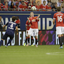 Manchester United's Wayne Rooney plasys Paris Saint-Germain during International Champions Cup play in Chicago Wednesday, July 29, 2015. (AJ Mast / AP Images for International Champions Cup)