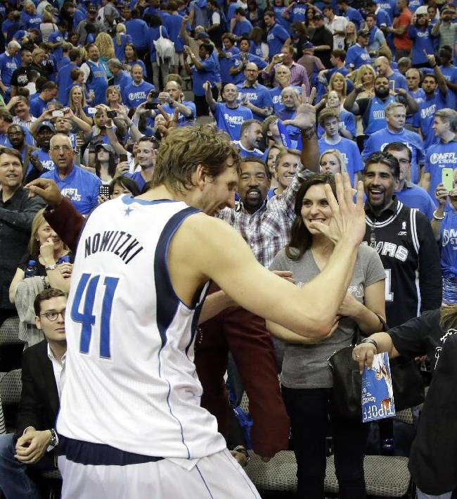 Dallas Mavericks' Dirk Nowitzki (41), of Germany, celebrates with fans after a 113-111 win over the San Antonio Spurs in an NBA basketball first-round playoff series on Friday, May 2, 2014, in Dallas