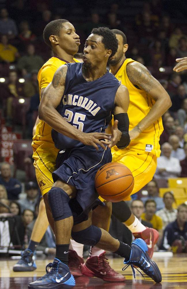 Concordia-St. Paul guard Terez VanPelt (25) looses the ball as he drives by Minnesota guard Deandre Mathieu, left, and forward Maurice Walker, back during the second half of an NCAA college exhibition basketball game, Monday, Nov. 4, 2013, in Minneapolis. Minnesota won 101-67