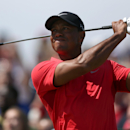 Tiger Woods of the US plays a shot off the 16th tee during the final round of the British Open Golf championship at the Royal Liverpool golf club, Hoylake, England, Sunday July 20, 2014. (AP Photo/Jon Super)