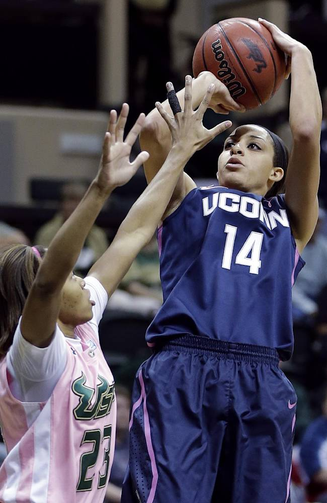 Hartley scores 18, No. 1 UConn tops USF 63-38