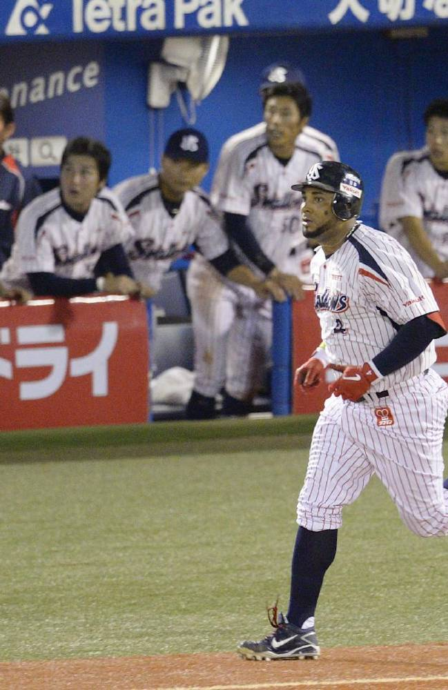 Yakult Swallows' Wladimir Balentien heads to first while watching the flight of his 55th home run of the season off Hiroshima Carp's Kan Otake in the sixth inning of their regular season game at Jingu Stadium in Tokyo Wednesday, Sept. 11, 2013. Former major leaguer Balentien matched Japan record set by Sadaharu Oh in 1964 and equaled by ex-major leaguers Tuffy Rhodes in 2001 and Alex Cabrera in 2002. Hiroshima's catcher is Yoshiyuki Ishihara