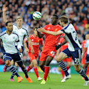 Liverpool's Mario Balotelli, middle, attempts to break through West Brom's Gareth McAuley, right, and Joleon Lescott, left, during the English Premier League soccer match between West Bromwich Albion and Liverpool at the Hawthorns, West Bromwich, England, Saturday, April 25, 2015. (AP Photo/Rui Vieira)