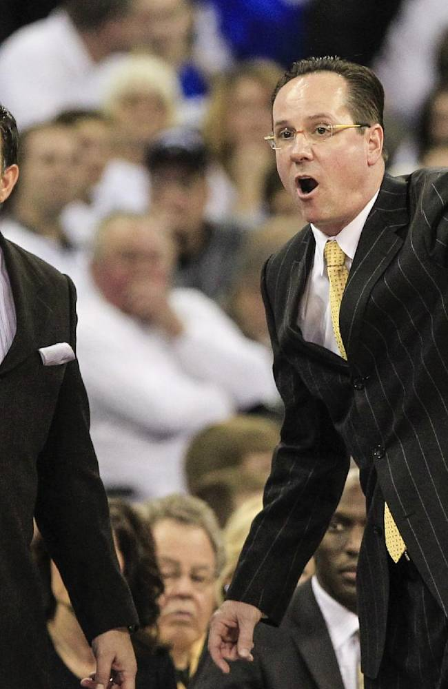 In this March 2, 2013 file photo, Wichita State head coach Gregg Marshall, right, and associate head coach Chris Jans, left, yell instructions in the first half of an NCAA college basketball game against Creighton in Omaha, Neb. Bowling Green State University has hired Jans as its new head coach, replacing the fired Louis Orr.  Jans has been Wichita State's associate head coach since 2011-12