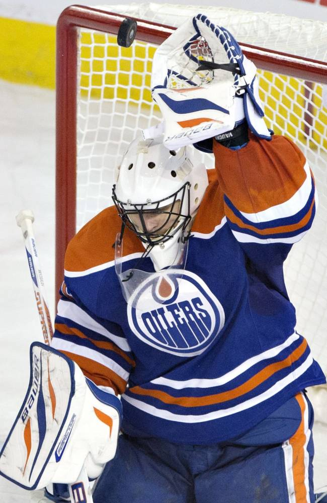Edmonton Oilers goalie Ilya Bryzgalov (80) is scored on by the St. Louis Blues during the third period of an NHL hockey game in Edmonton, Alberta, on Saturday, Dec. 21, 2013