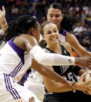 San Antonio Silver Stars' Becky Hammon, center, is trapped by Phoenix Mercury's Alexis Hornbuckle, left, and Samantha Prahalis, back, in the first half of a WNBA basketball game Saturday, Sept. 1, 2012, in Phoenix.(AP Photo/Ross D. Franklin)