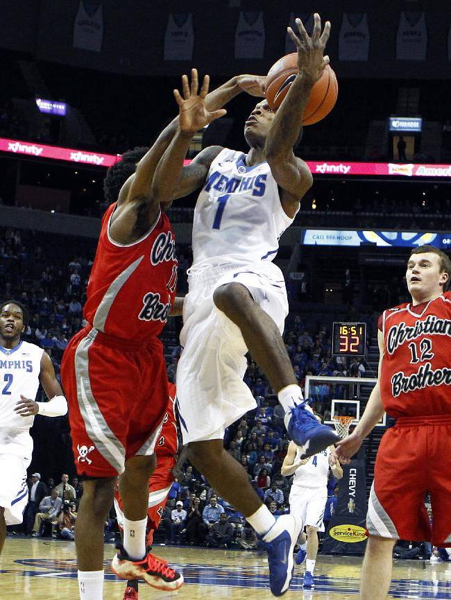 Memphis' Joe Jackson (1) is fouled why driving to the basket against Christian Brothers University's Harry Green, left, during the first half of an NCAA college basketball game Friday, Nov. 8, 2013, in Memphis, Tenn