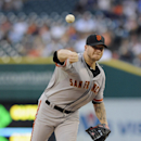 Peavy waits out delay, Giants beat Tigers 8-2 The Associated Press